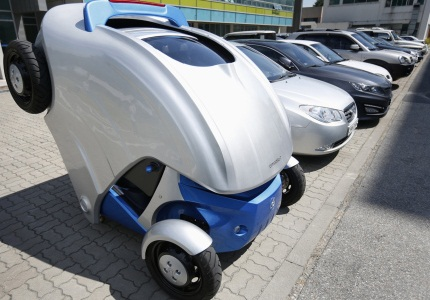 Armadillo-T, a foldable electric vehicle, folds up its rear at the Korea Advanced Institute of Science and Technology in Daejeon